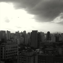 View West over Avenida Santo Amaro, São Paulo: high-rises and clouds.